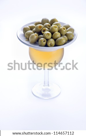 Beer and olives on white. High key.