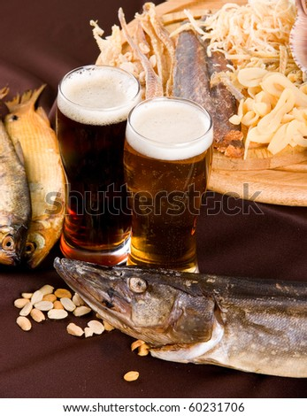 Beer and snacks set: chips, pistachio, shrimp and fish