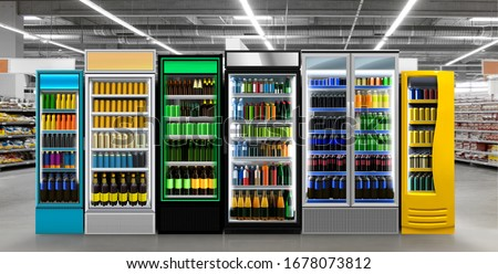 Beer and Soda pop drinks and soft drinks in Fridge-frezzer in Supermarket. Six Vertical Glass door fridge photo mockup Soda pop cans and plastic bottles in vertical freezer at supermarket.