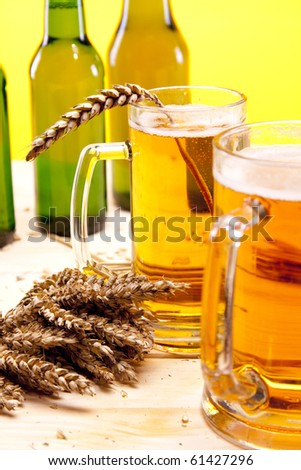 Beer and wheat on wooden flood!