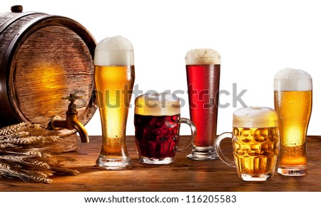 Beer barrel with beer glasses on a wooden table. Isolated on a white background. This file contains clipping path. - stock photo