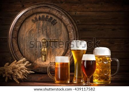 Beer barrel with beer glasses on wooden background