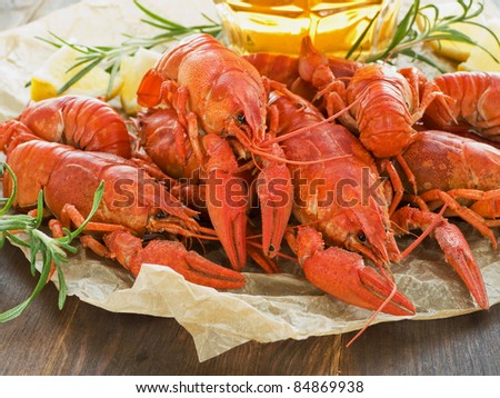Beer, boiled crawfish with lemon and rosemary. Shallow dof.