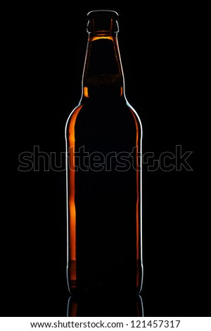 Beer botle on black background - stock photo