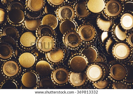 Beer bottle caps heap, unbranded metallic caps as pattern background.