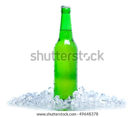 beer bottle in ice isolated on white