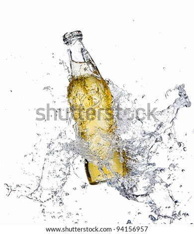 Beer bottle with splashing water