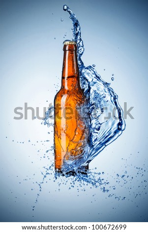 Beer bottle with water splash