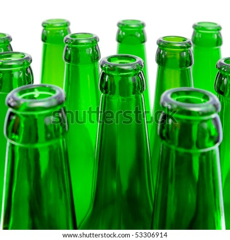 Beer bottles of green glass on a white background