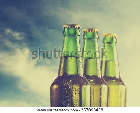 Beer bottles on the beach. Retro filter.
