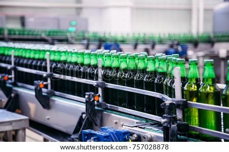 Beer bottles on the conveyor #757028878