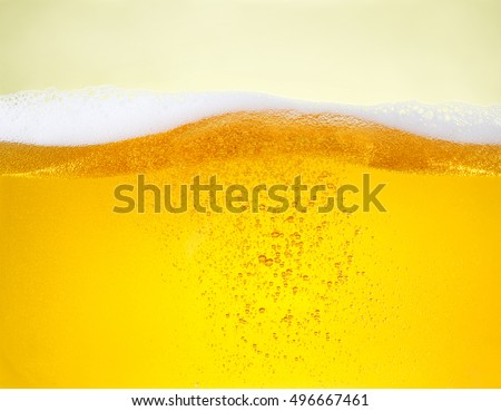 Beer bubbles. A little bit blurred on the edge of photo