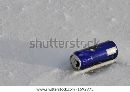 Beer can on snowy ground.