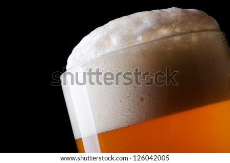 Beer froth in glass close-up