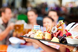 Beer garden restaurant in Bavaria, Germany - beer and snacks are served, focus on meal