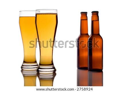 Beer glasses and bottles against white background