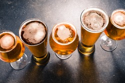 Beer glasses on dark table