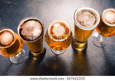 Beer glasses on dark table #367622333