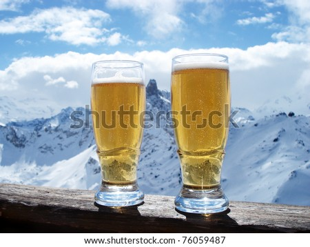 Beer glasses over Alps