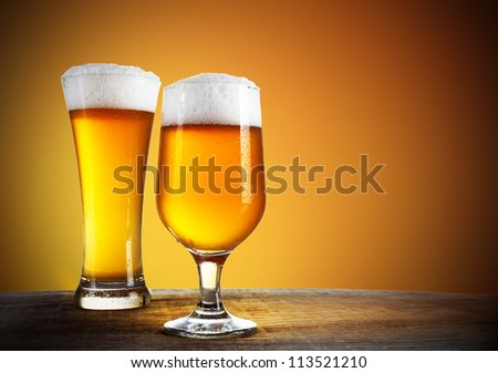 Beer glasses with gold background