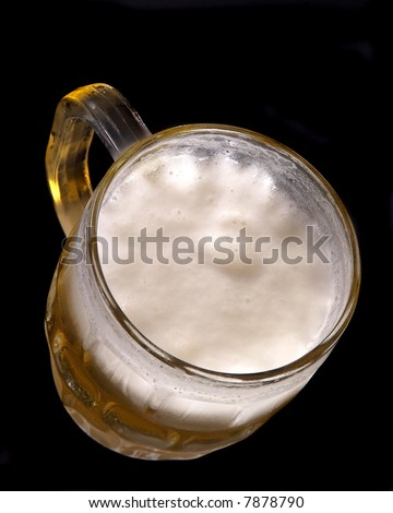 beer in a chilled mug on a black background