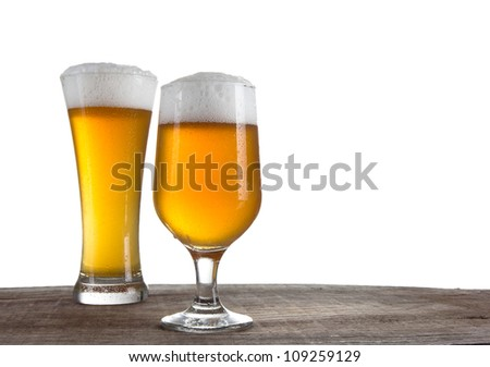 Beer in a glasses over white