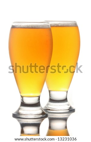 Beer in a pilsner glass, isolated over a white background
