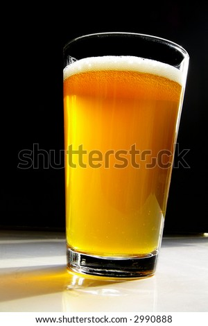Beer in a pint glass on dark background