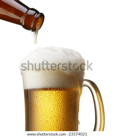 beer in bottle pouring into mug, isolated