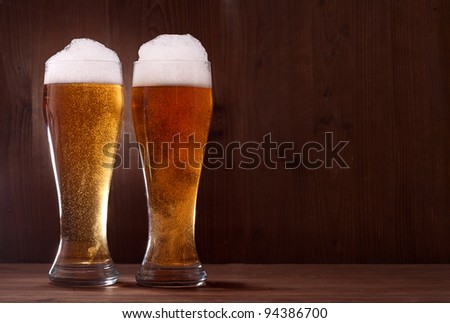 beer in glass on wooden background