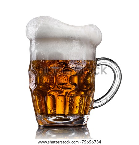 Beer in glass with water drops isolated on white