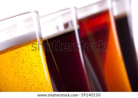 Beer in mug on white background
