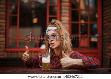 Beer in mug on wooden table. woman. Beer. #1403467211