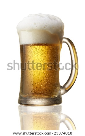 beer in mug with foam over flow