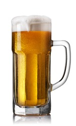beer in mug with spilling foam and bubbles isolated on white background