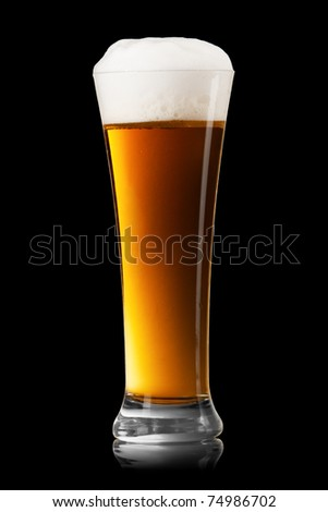 Beer into glass on a black