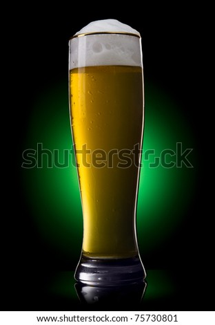 Beer into glass on a green gradient