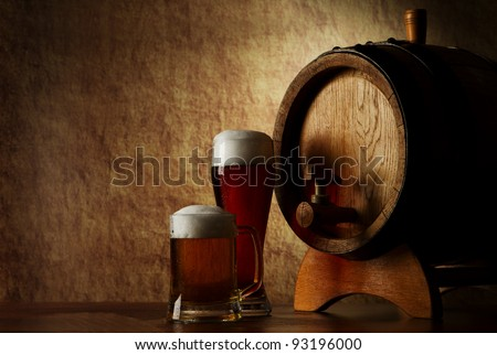 Beer into glass on a old stone and old barrel