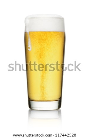 Beer into glass with reflection isolated on a white background