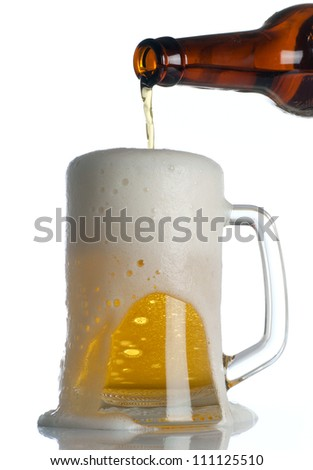 Beer is Pouring into mug on white