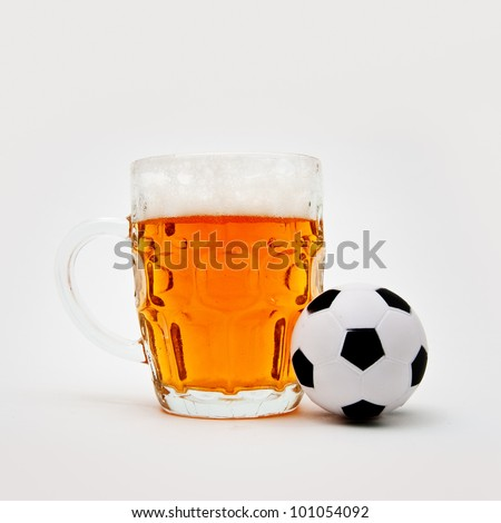 Beer jug and small soccer ball
