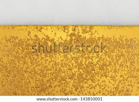 Beer - light golden beer in a glass, texture