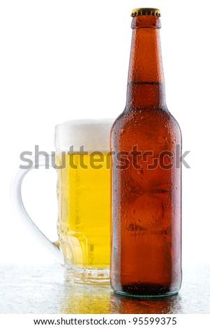 Beer mug and bottle isolated on white background, studio photo