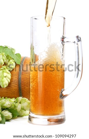 Beer mug, beer barrel and a branch of green hops