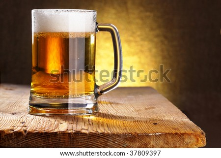 Beer mug close-up on the wood table