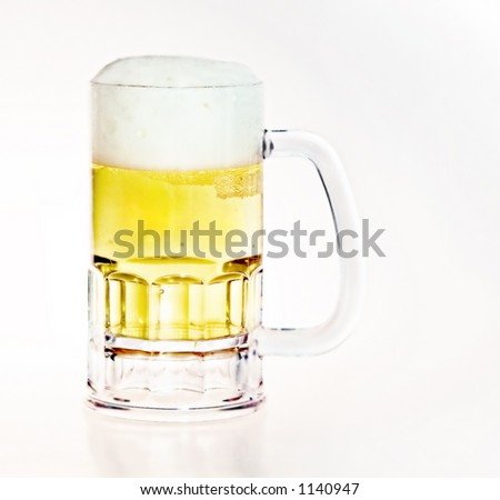Beer mug filled with fresh golden draft beer with a head - plenty of white space for logo or text.