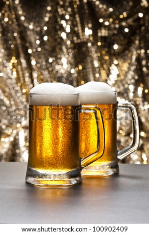 Beer mug in front of a glittering background with a cool beer