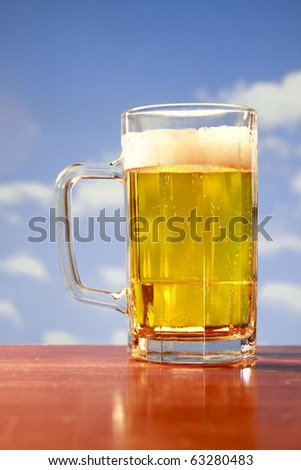 beer mug on blue sky