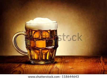Beer mug on rustic wooden table