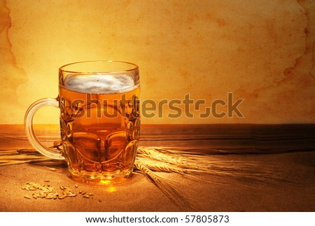 beer on sacking with wheat in ambient light  still-life